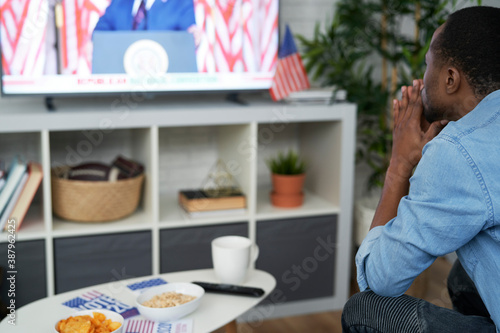 Black man stressed while watching USA election results Fotobehang