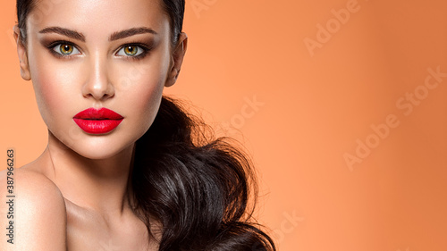 Beautiful white girl with a red lipstick on lips Fototapeta