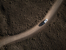 Aerial View Of A Recreational Vehicle On Dirt Road, Lanzarote, Canary Islands, Spain.