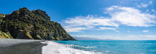 Nonza Beach In Corsica Under A Great Blue Sky