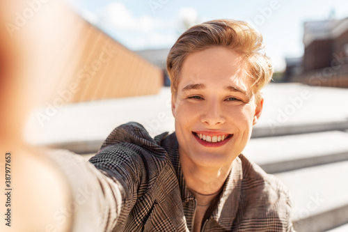 Valokuvatapetti leisure, technology and people concept - happy smiling nice young man or teenage