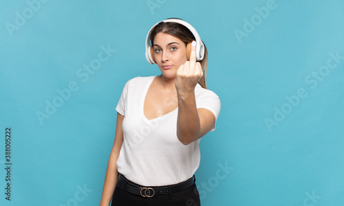 Canvastavla young blonde woman feeling angry, annoyed, rebellious and aggressive, flipping t