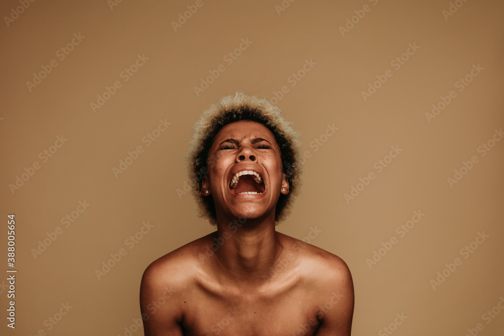 Fototapeta Portrait of african american female shouting in pain