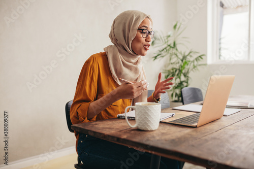 Fotografie, Obraz Muslim business woman on a zoom video call