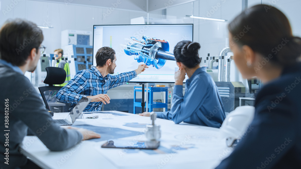 Fototapeta Modern Factory Office Meeting Room: Diverse Team of Engineers, Managers and Investors Talking at Conference Table, Use Interactive TV, Analyze Sustainable Energy Engine Blueprints. High-Tech Facility