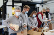 canvas print picture - Group of volunteers in community charity donation center, food bank and coronavirus concept.