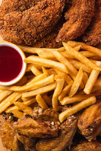 French Fries, Chicken Wings And Fish Detail Shot