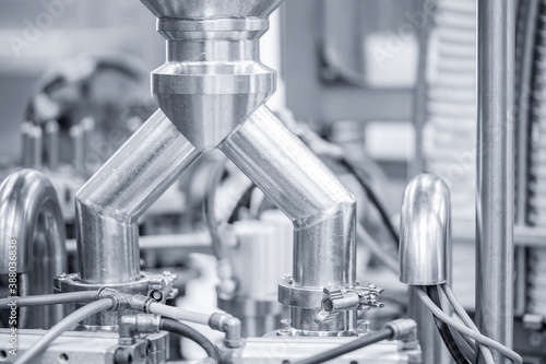 Obraz Industrial automation factory food equipment pipe stainless tubes - fototapety do salonu