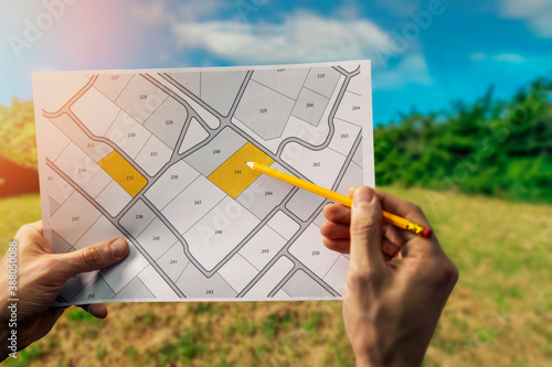Obraz sale of building plot of land for house construction. cadastral map on field background - fototapety do salonu