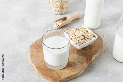 Obraz Homemade non dairy alternative milk made from oat flakes. - fototapety do salonu