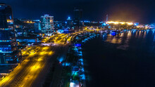 Road, Lights And Sea At Night. Luanda City Captured From The Top