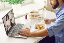 Young Man Having Virtual Lunch...