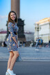 fashionable girl in blue dress smiles