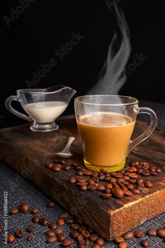 Fototapeta coffee drink with milk on a dark background