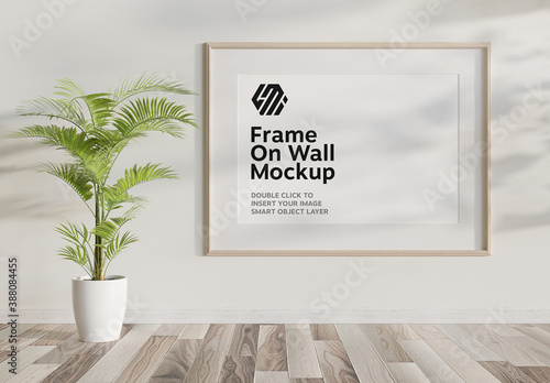 Obraz Wooden Frame Hanging on White Interior Mockup - fototapety do salonu