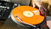 An Orange Record With A DJ's H...