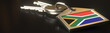 canvas print picture - Keys and house keychain with flag of South Africa. National property rental or real estate market concepts. 3d rendering