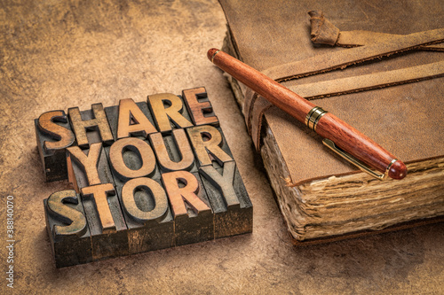 Fototapeta share your story word abstract in letterpress wood type with an antique journal, business, education, communication concept obraz
