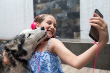 Girl Taking Selfie With Dog Th...