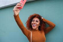Cheerful Afro Young Woman Taki...