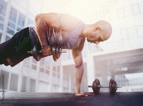 Tela Athletic man training muscles at the gym