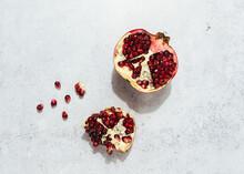 Fresh Juicy Pomegranate On Cem...