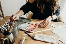 Women Painting With Water Colors