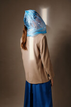Anonymous Woman With Blue Bag On Head