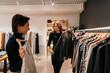 Women choosing outfit in fashion boutique