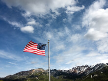 American Flag With Snowy Mountain Background