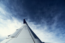 An Airplane Wing Points Toward...