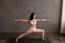 Determined Ethnic Woman Standing In Warrior Pose