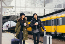 Asian Couple On A Train Station In Winter