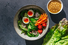 Bowl Of Salad With Dressing An...