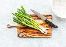 Fresh Green Onions On Wood Cut...