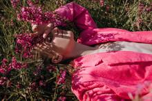 Woman In Bright Suit In Summer Fields