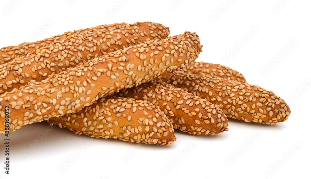 Fototapeta many bread sticks with sesame - isolated on the white background