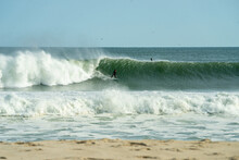 Surfer Carving On A Green Wave.