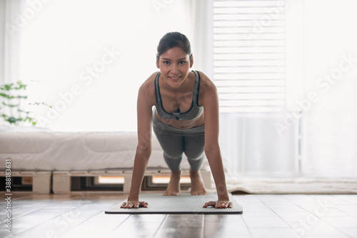 Papel de parede Attractive Asian woman practice yoga Plank pose to meditation in bedroom after w