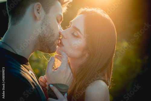 Fototapeta Romantic kiss. Lovely couple of lovers kissing.