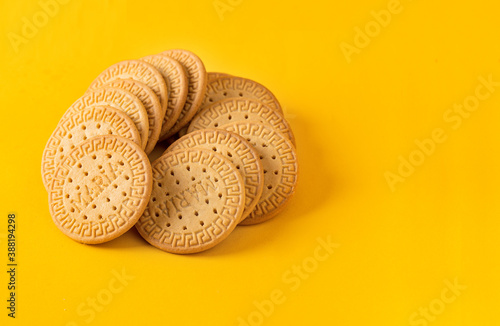 Carta da parati Many Marie biscuits  on bright yellow background