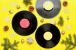 Leinwandbild Motiv Vinyl disks and Christmas decor on color background