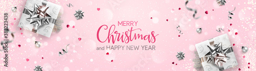 Obraz Merry Christmas and New Year text on pink background with silver gift boxes, fir branches, ribbons, decoration, sparkles, confetti, bokeh. Xmas card. Vector Illustration, holiday realistic vector - fototapety do salonu