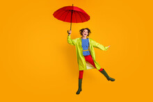 Full Length Photo Portrait Of Elegant Girl Jumping Up With Open Umbrella Isolated On Vivid Yellow Colored Background