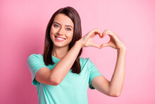 Photo Portrait Of Flirty Girlfriend Keeping Hands In Heart Shape On Valentines Day In Teal T-shirt Isolated On Pastel Pink Color Background