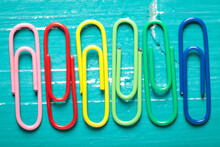 Colorful Paperclips On Turquoi...