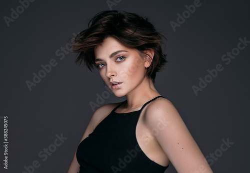 Fototapeta Portrait of a young beautiful brunette girl with short stylish hair obraz