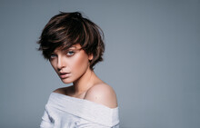 Portrait Of A Young Brunette Girl With Stylish Short Hair