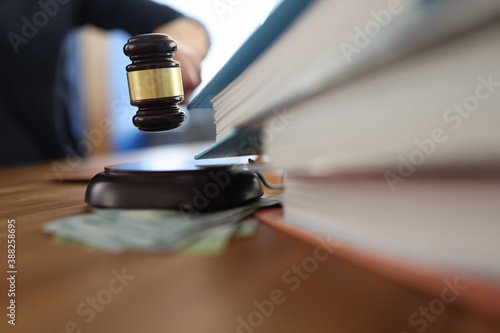 Wooden gavel for judge on table next to folder with documents Fotobehang