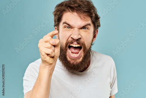Tela Bearded man emotions facial expression gestures hands close-up blue background
